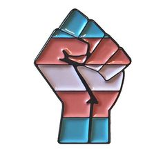 This pin is for all trans and gender variant people. It is pride in yourself, pride in the trans community, and pride in our history as trans people. It is a 30mm black enamel pin in the shape of a fist, detailed with the colours of the trans pride flag. 10% of profits from this pin go to Action For Trans Health www.actionfortranshealth.org.uk Some of the things that Action for Trans Health seeks to do is improve trans people's access to healthcare, give advice in regards to…