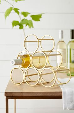 A brushed goldtone finish lends elegant shine to a graceful metal wine rack sized to hold six bottles of your favorite vintage. Wine Rack Storage, Wine Racks, Pot Racks, Nordstrom Sale, Bottle Rack, Bottle Opener, Heart Pillow, Nordstrom Anniversary Sale, Crystals
