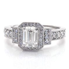 This classic style is done in clean, simple lines and covered in sparkle. The band and halo are done in micro pave and the center stone is an emerald cut. Emerald Art Deco from Knox Jewelers