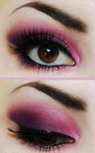 Pink and black eye makeup with black liner and false lashes.