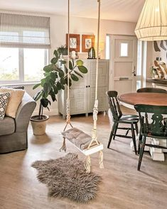 Changing up a living room with a swing #livingroom