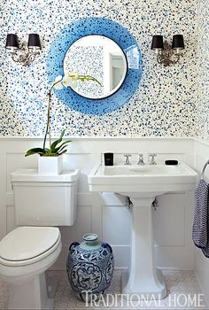 """Spatter"" wallpaper and a vintage Fontana Arte mirror make for a playful bath. - Photo: Eric Roth / Design: George Nunno and Jon Maroto"