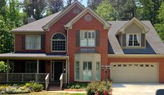 Exterior Paint Colors with Red Brick Exterior Traditional with Arch Window Bay Window