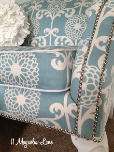 White contrast cording piping and nailhead trim on a $15 thrift store loveseat reupholstery project.