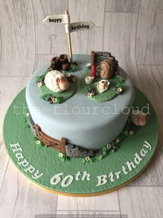 A birthday cake for a lady who loves country walks and sheep.