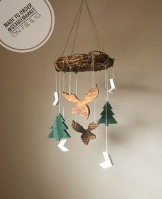 Precious! How precious is this lumberjack woodland Baby mobile? It has moose and pointy trees to give it the perfect rustic feel and is complete with a grapevine and twine hanger. It would be great in a gender neutral, boys, or girls nursery. Chevron arrows, diy mobile ideas, unique nursery decor, woodland, lumberjack themed nursery • #moose #forest #trees #nursery #baby #mobile #genderneutral #boys #girls #woodland #lumberjack #theme