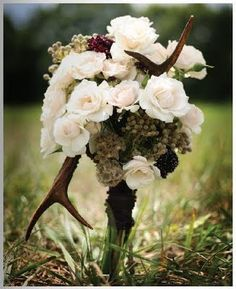 """Bouquet with antlers. This is how you do a classy """"hunter type theme"""" wedding Camo Wedding, Wedding Bells, Wedding Events, Rustic Wedding, Our Wedding, Dream Wedding, Weddings, Wedding Stuff, Wedding Bouquets"""