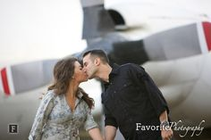 © Favorite Photography | Engagement Pictures | NAS Jacksonville Engagement Photos | Engagement Picture Pose Ideas | Kissing Engagement Picture | Airplane Engagement Photo