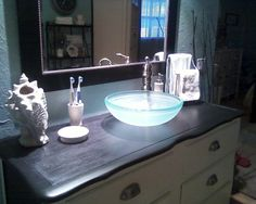 DYI....my friend turned this dresser into a functional bathroom vanity and added a sink from leows....love it!! ... Uploaded with Pinterest Android app. Get it here: http://bit.ly/w38r4m