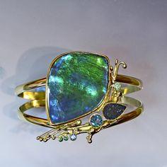 Ammonite bracelet with drusy, topaz & tsavorite in 22k and 18k gold.  www.kalledjewelrystudio.com