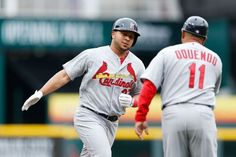 Jhonny Peralta rounds the bases after hitting a two-run home run in the second inning against the Cincinnati Reds. Cards won 7-6  4-03-14