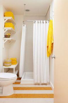 Broad stripes make narrow bathroom feel wider.