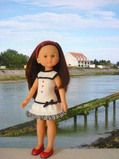 Robe pour poupée Chérie - http://p4.storage.canalblog.com/46/74/1066432/100425611.pdf