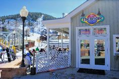 Best Park City Restaurants: The Bridge Cafe & Grill. Take a break from the slopes and take The Town Lift to the bottom of Main St. for some great grub!