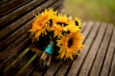 Sunflower Wedding Bouquets do this with tiffany blue or latte ribbon and or twine