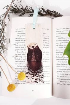 Keep track of your place in a favourite book, journal or magazine with this unique handmade wood otter bookmark. You will no longer need to reach for an old receipt or scrap of paper to mark your place…and no more folding the corners of pages! Each bookmark is handmade in Australia using lightweight, flexible wood, gorgeous photo image transfer and finished with coloured ribbon. #stitchandwood #otter #bookmark #giftidea Flexible Wood, Wood Transfer, Ribbon Colors, Book Journal, Otters, Book Lovers, Are You The One, Bookmarks, Great Gifts