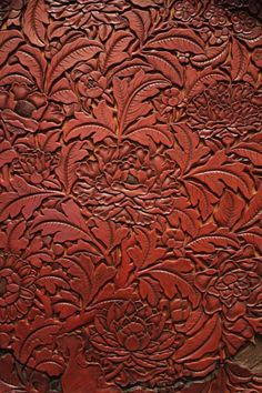 Chrysanthemum plate in the Ashmolean, detail. carved red lacquer