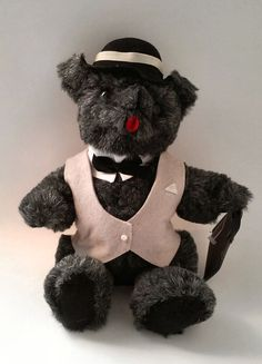 Kent Collectibles Inc. Business Suit Bear  1985 Jean Steel Original  Stands app 12 inches tall. Gray coloring and a tan suit and black brief