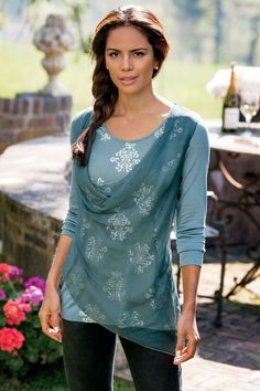 In a crinkled silk our, Silk Overlay Top takes on European influences with foil-print medallions.