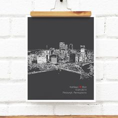 Sleek and contemporary, this personalized art print features an outline drawing of any city skyline you choose - the skyline of Pittsburgh is shown here, but you can request any city of your choice! Each design is personalized with name(s), date and location. Great as a wedding gift, wonderful engagement or anniversary keepsakes, but also for a friend or family member moving away or to capture memories of a favorite destination. See more City Skylines here: http://etsy.me/2rx8e...