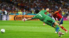 Spain 4-0 Italy (Juan Mata [13] of Spain scores their fourth goal past Gianluigi Buffon [1] of Italy during their UEFA EURO 2012 final against Italy.)