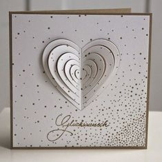 handmade card: Pistils: Congratulations ... white and gold ... concentric hearts die with raised layers ...