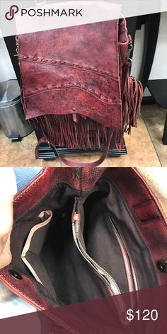 Italian leather purse. Excellent condition! This Is all leather in the desired color of maroon!  Has zippered pockets, a handle and an over the shoulder/cross body strap Bags Hobos