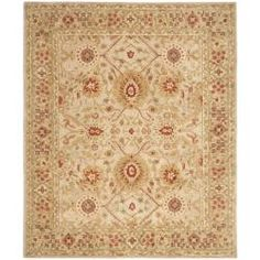 area rug; a bit traditional, but all the right colors