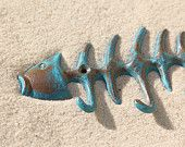 http://www.etsy.com/treasury/MTczMjYxOTB8MjcyMTQ0NzA4OQ/beautiful-bones?ref=pr_treasury  Beach Decor Cast Iron Fish Bone Hook Blue Distressed by SEASTYLE