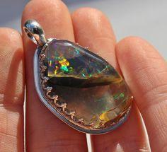 Large Opal Pendant, Statement Piece, Opal, Opal Necklace, Birthstone, Sterling Silver, Contraluz Opal, Ethiopian Opal by SagesLeaf on Etsy https://www.etsy.com/ca/listing/522456889/large-opal-pendant-statement-piece-opal