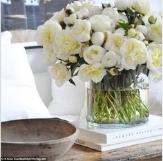 Mystery: Khloe Kardashian shared snap of a beautiful bouquet of white peonies she received...