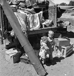 """Migratory children living in """"Rambler's Park."""" They have lived on the road for three years. Yakima Valley, Washington, 1939"""