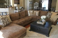 Mixing patterns on pillows and the coffee table decor and white accent pieces in back