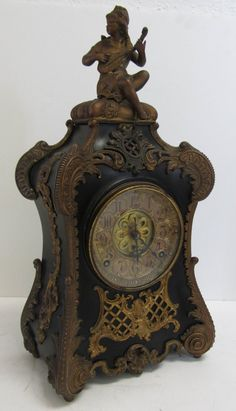 19th C. Figural spelter and bronze mantle clock