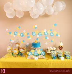Nice backdrop to food table with balloons & bday message