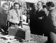 1959 - Ex-Prime Minister Konstantinos Karamanlis examines the mock-up of the hotel. With him is the later President of the Republic, Μr Konstantinos Tsatsos, ex-Minister Mr Emmanuel Kefalogiannis and architects Mr Antonis Georgiadis and Mr Spiros Staikos. Hilton Hotels, Greek History, Athens Greece, The Republic, Egypt, Nostalgia, The Past, Black And White, Prime Minister