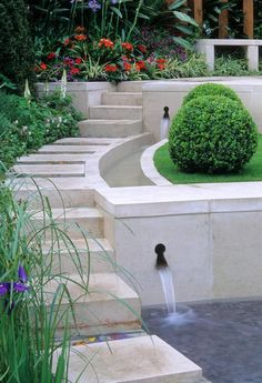 Contemporary style water feature with steps, rill and retaining wall.