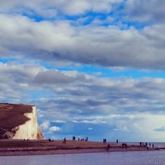 People enjoying the coast at the beautiful Seven Sisters.. #people #cuckmere #seadefence #beautyspot #beach #sea #river #reflection #countryside #countrywalk #coast #nationaltrust #nature #sevensisters #clouds #tranquil #landscape #seascape #landmark #grass #riverbank #sussex #cloudscape #contrast #naturereserve #natural #heathfield #wildlife #birds #weald