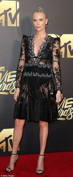 Hollywood beauties: Charlize Theron and Jessica Chastain brought sheer elegance to the MTV Movie Awards in Los Angeles on Saturday night