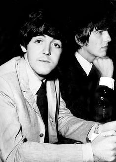 Paul looks at the camera of course while George possibly thinks of food...xD