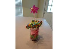 lollipop arrangement in a mason jar with a pinwheel = super cute lollipop stand!