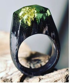 Rounding out our week of rings, we have this interesting resin and wood piece by…