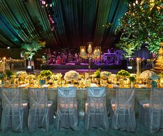 The green and purple lighting makes this tented wedding recaption even more fabulous!