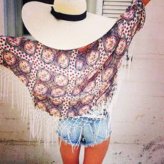 Millau printed fringed kimono is a must have!