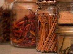 Put your favorite fall scents—we're partial to cinnamon, nutmeg, and cloves—front and center in your home by storing them in different-sized jars.
