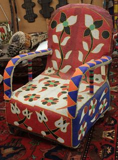 Beaded chair, Yoruba tribe, Nigeria, with floral design and red backrest.