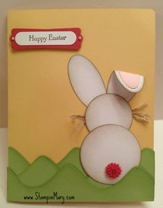 Simple punched bunny - circles and ovals and a button tail!  Love the flipped back ear and the rolling green hills.   Handmade Easter card.