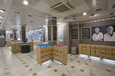 pharmacy in Madrid - shipping cartons become part of retail fixtures with store display area