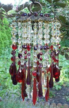 Beaded Wind Chimes Ideas - A sparkling clear crystal chandelier wind chime and sun catcher hanging in the t. Chandelier Bougie, Chandeliers, Purple Chandelier, Crystal Wind Chimes, Diy Wind Chimes, Mobiles, Sun Catchers, Dream Catchers, Yard Art