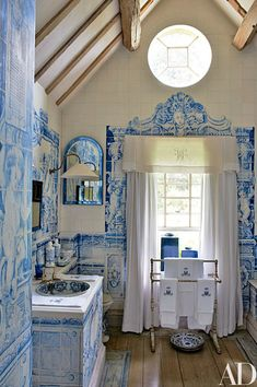 The room's vanity is covered in trompe l'oeil tiles painted by Kaffe Fassett according to a Hempel design.